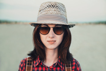Portrait of woman in sunglasses and hat
