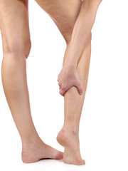 Woman massaging her painful leg calf.