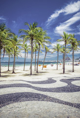 Copacabana Beach with palms and landmark mosaic in Rio
