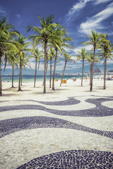 Copacabana Beach with palms and landmark mosaic