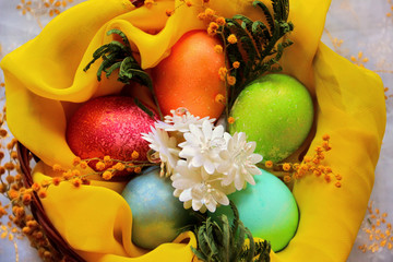 Easter eggs in basket, painted in different colors