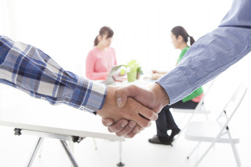 Contract formation, handshake, businessman, casual wear
