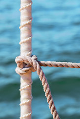 Sailboat detail of nautical rope knots. Decorative aspect