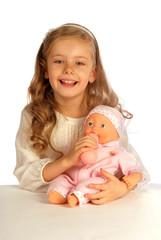 girl feeding her baby-doll