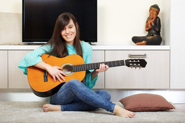 young brunette play guitar