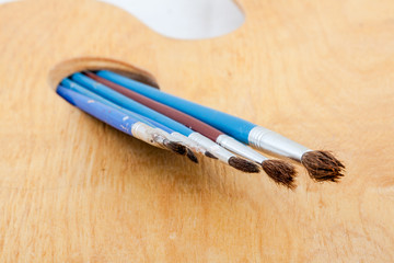 Paintbrushes on palette.