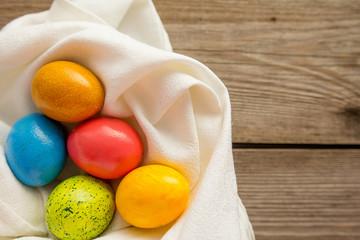 Five easter eggs on white napkin