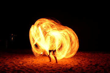 Amazing fire show on the beach at Thailand