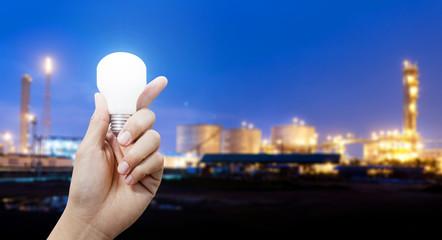 Light energy for industry, Hand holding light bulb in industrial