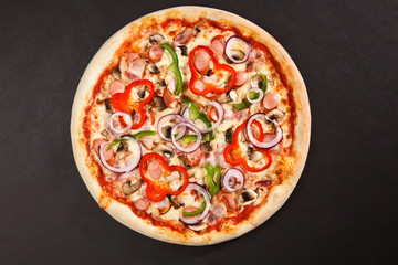 Tasty Italian pizza with mushrooms pepper onion sausage