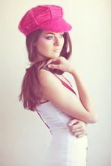 Beautiful smiling woman in pink beret