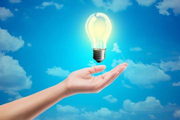 Ideas bulb light on a hand