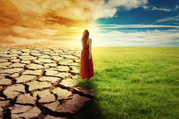 Climate Change Concept Woman walking through opened field