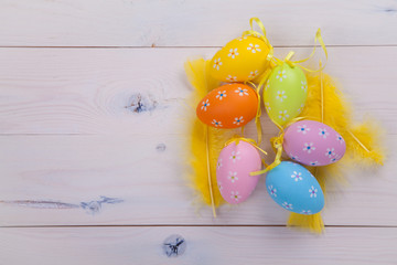 Painted eggs and yellow feathers