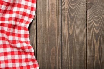 Top. old wooden table with red picnic tablecloth and ...