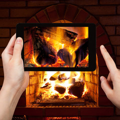 tourist photographs of fire in fireplace
