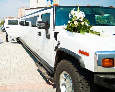 wedding big limousine waiting for newlywed