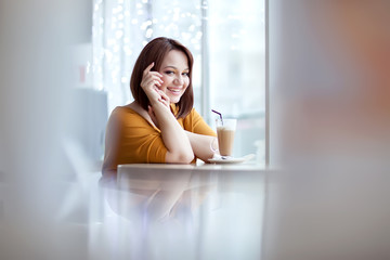 Happy woman are relaxing in cafe