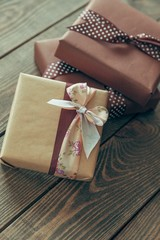 Gift. two elegant gift boxes on a wooden background