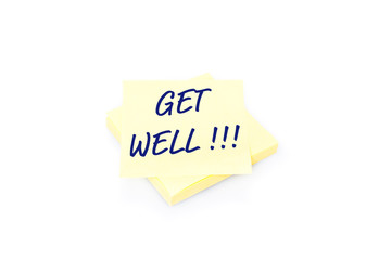 Yellow sticky note on block with text Get Well