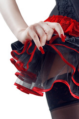 Female bottoms in black and red skirt on white background