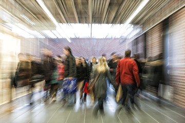 Crowd of people rushing through corridor, zoom effect, motion bl