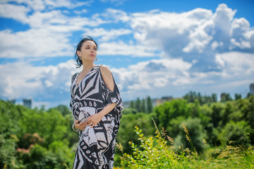 Pregnant lovely woman in sunny summer day