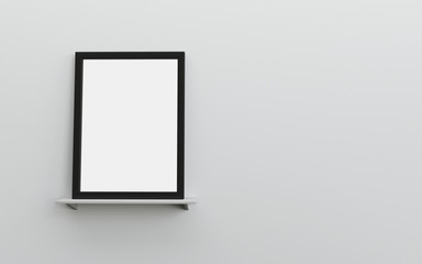 Blank frame on white shelf and white wall with space for text