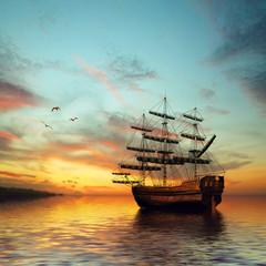 Sailboat against beautiful sunset landscape