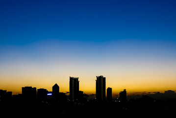 Silhouette building in Bangkok at sunset.