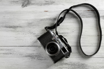 Old retro camera on wooden background