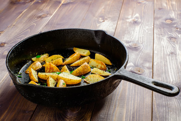 Hot fried potatoes in a pan