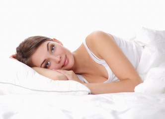 Beautiful girl lying in bedroom at early morning
