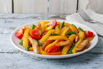 fried sliced chicken fillet bell peppers tomatoes  green beans