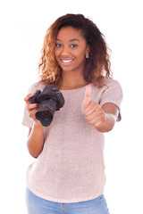 African American photographer holding a dslr camera making thumb