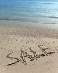 text on sand - sale