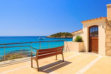 Wall Mural - Bench on coast holiday village Camp de Mar, Majorca island