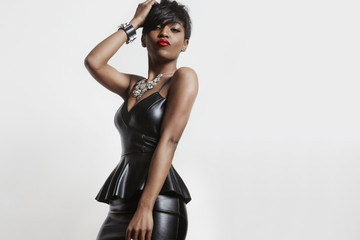 amazing, sexy black woman in a leather dress