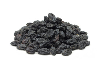 a handful of small black raisins on a white background