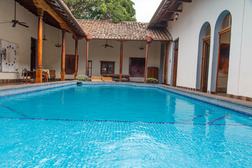 pool in garden in colonial house