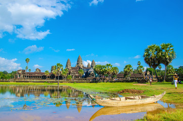 Angkor Wat with old boat seen across the lake, Cambodia