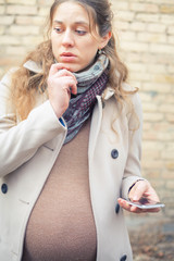 pregnant woman calling by mobile phone