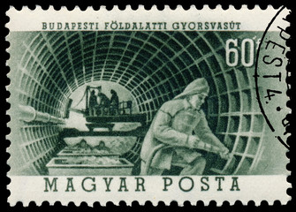 Stamp printed in Hungary shows construction of Metro in Budapest