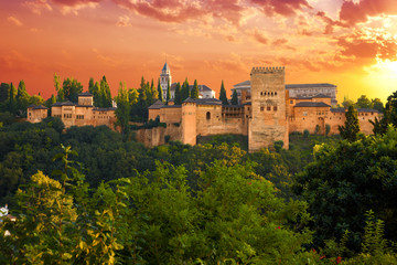 Wall Mural - Alhambra de Granada. Exterior view of Nasrid Palaces at sunset