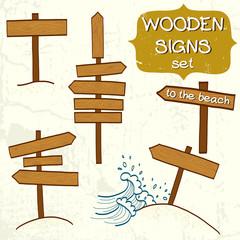 Hand drawn cartoon beach wooden signs