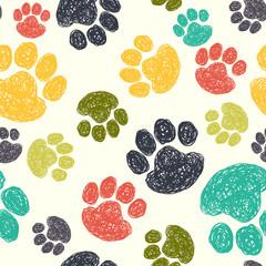 Dog's paw prints seamless pattern.