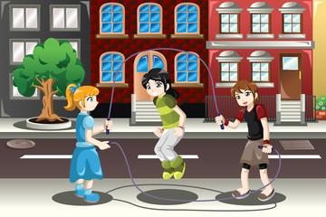 Kids playing double dutch