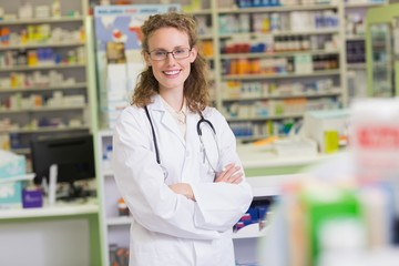 Pharmacist in lab coat with stethoscope and arms crossed