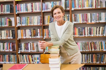 Teacher smiling at camera at library