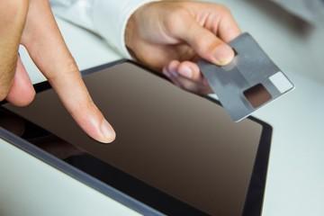 Man using tablet for online shopping
